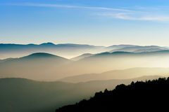 Aerial view of colorful autumnal mountains, foggy sunset Royalty Free Stock Photography