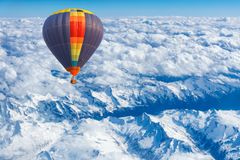 Aerial view from colorful hot air balloon flying over mountains Royalty Free Stock Images