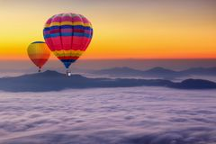 Aerial view from colorful hot air balloons flying over with the mist at Pha Tung mountain in sunrise time. Chiang Rai Province, Thailand Stock Photography