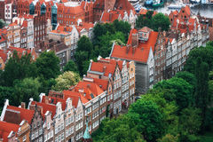 Aerial view of colorful houses in Old Town, Gdansk, Poland. Red roofs, old buildings and colorful houses in Old Town Stare Miasto in Gdansk, aerial view from Stock Photo