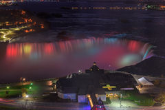 Aerial view of colorful lights on Niagara Falls at night Royalty Free Stock Photos