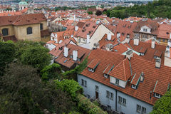 Aerial view of the colorful orange roofs of old houses in the city of Europe Prague Royalty Free Stock Image