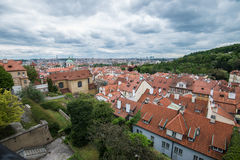 Aerial view of the colorful orange roofs of old houses in the city of Europe Prague Stock Images