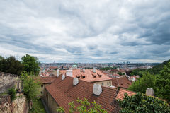 Aerial view of the colorful orange roofs of old houses in the city of Europe Prague Royalty Free Stock Photography