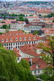 Aerial view of the colorful orange roofs of old houses in the city of Europe Prague Stock Photo