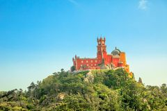 Sintra Pena Palace. Aerial view of colorful Pena Palace on top of a hill above Sintra in a sunny day with blue sky. Panorama of Palacio da Pena, a National Stock Image