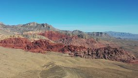 Aerial View of Colorful Rock Formations in Red Rock Canyon. Spectacular rock formations are found in Red Rock Canyon State Park just outside of Las Vegas, Nevada stock video footage