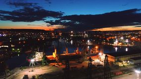 Aerial view of colorful sunset over sea port and industrial cranes, Varna seaport, Bulgaria.  stock footage