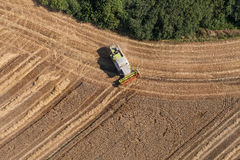 Aerial view of combine on the harvest field Royalty Free Stock Photography