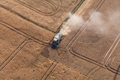 Aerial view of combine on the harvest field Royalty Free Stock Images