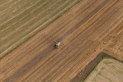Aerial view of combine on the harvest field Royalty Free Stock Image