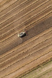 Aerial view of combine on the harvest field Stock Image