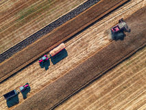 Aerial view of combine on harvest field Royalty Free Stock Photography