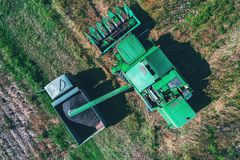 Aerial view of Combine harvester agriculture machine harvesting royalty free stock image