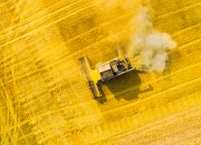 Harvest of wheat field. Aerial view to combine harvester. stock image