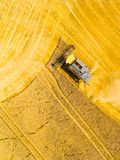 Harvest of wheat field. Aerial view to combine harvester. royalty free stock photos