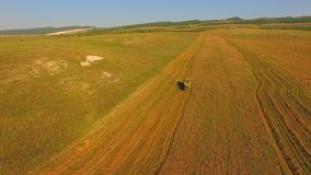 AERIAL VIEW. Combine Harvester On A Wheat Field Against Blue Sky stock footage
