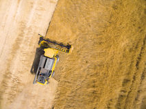 Aerial view of combine harvester. Royalty Free Stock Images