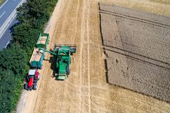 Aerial view on combine harvester working on the large wheat field in Germany Royalty Free Stock Image