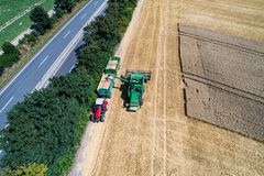 Aerial view on combine harvester working on the large wheat field in Germany Royalty Free Stock Images