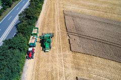 Aerial view on combine harvester working on the large wheat field in Germany Royalty Free Stock Photos