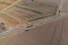 Aerial view on combine harvester working on the large wheat field in Germany Stock Photography
