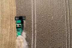 Aerial view on combine harvester working on the large wheat field in Germany Royalty Free Stock Photography