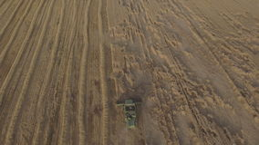 Aerial view combine harvesting a field of wheat. Two combine harvester on a wheat field at harvest.Aerial view of agricultural land with harvester.Combine stock video