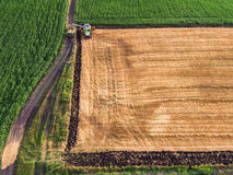 Aerial view of the combine working on the large wheat field Royalty Free Stock Photography