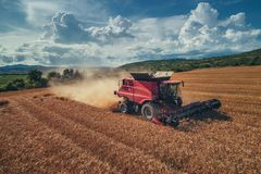 Aerial view of combine on harvest field stock image