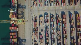 Aerial view of the commercial port of Valencia. Container terminal and ship during loading.  stock footage
