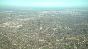 Aerial view of Compton, view from window seat in an airplane. California, U.S.A stock video