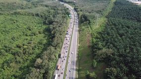 Aerial view of congested highway in 4K. Backlog highway moving towards a town during festive holiday season stock video footage