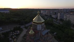 Aerial view of constructed church in Lviv, Ukraine. Aerial shot flying around the church stock footage