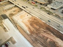 Construction of elevated highway in progress in Houston, Texas,. Aerial view construction of elevated highway in progress in Houston, Texas, USA. Workers and Royalty Free Stock Images