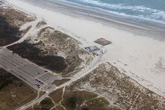 Aerial view construction new beach pavilion at Dutch island Terschelling. With large car park stock photo