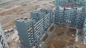 Aerial view of construction site, building work process modern an apartment panel house. Cladding and decoration of