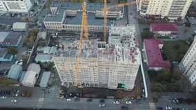Aerial view of construction site with crane and building. Video. Top view of big development construction and. Architecture stock video footage