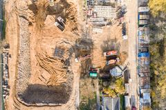 Aerial view of construction site with heavy industrial machinery for ground work. Aerial top view of construction site with heavy industrial machinery for ground royalty free stock image