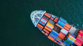 Aerial view container cargo ship, business freight shipping international by container cargo ship in the open sea.