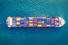 Aerial view of container cargo ship in sea stock image