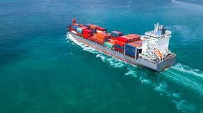 Aerial view container ship carrying container for import and export, business logistic and freight transportation by ship in open stock photos