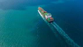 Aerial view container ship carrying container for import and export, business logistic and freight transportation by ship in open royalty free stock images