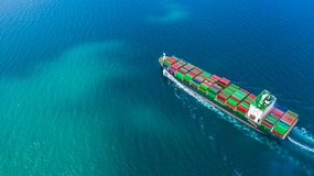 Aerial view container ship carrying container for import and export, business logistic and freight transportation by ship in open royalty free stock photo