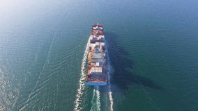 Aerial view of container ship floats in the ocean after loading in port of China