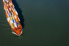 Aerial view of a container ship going upstream in the St. Lawrence River near the port of Montreal in Canada stock photography