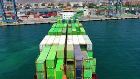 Aerial view of the container ship JSP Rover, maneuvering in the port of Alicante.