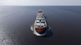 Aerial view of container ship sailing in the sea stock photos