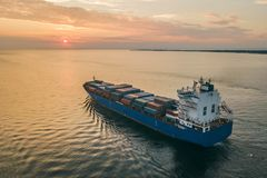 Container ship sailing in sea royalty free stock images