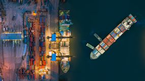 Aerial view container ship from sea port working for delivery containers shipment. Suitable use for transport or import export to stock photo